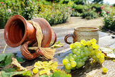 Old ceramic jug, mug and fresh grape — Stock Photo