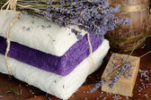 Natural soap, towels and lavender — Stock Photo