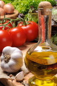 Set of fresh vegetables with olive oil — Stock Photo
