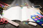 School notebook with magic light — Stock Photo