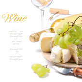 White wine with French cheese selection — Stock Photo