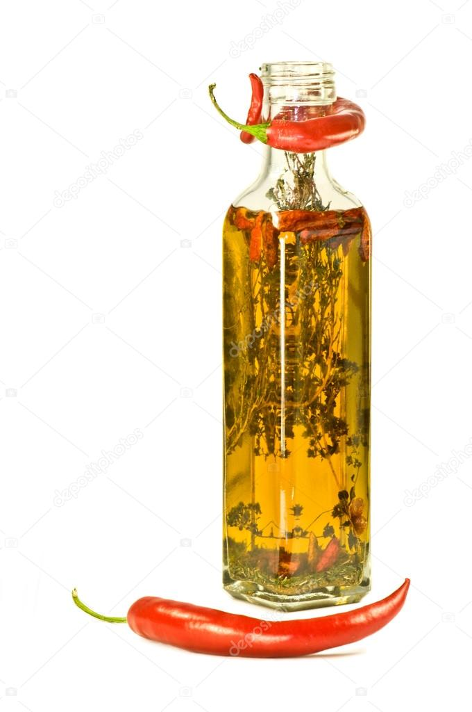 Olive oil with herbs and red pepper in a bottle — Stock Photo #12727834