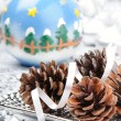 Stock Photo: Pine cones in Christmas setting
