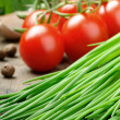 Fresh cherry tomatoes and chives — Stock Photo #12741603