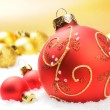 Stock Photo: Red Christmas balls on golden background