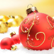 Red Christmas balls on golden background - Stock Photo
