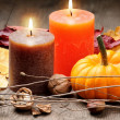 Foto Stock: Autumn setting with candles and pumpkin
