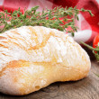 Freshly baked bread and thyme - Stock Photo