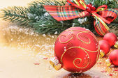 Red Christmas balls on festive background — Stock Photo