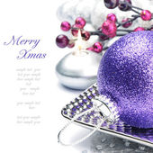 Purple Christmas ball on festive background — Stock Photo