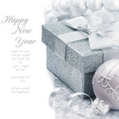 Christmas gift box in silver tone — Stock Photo