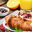 Breakfast with orange juice, fresh croissant and cake — Stock Photo