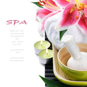 Spa setting with candles and pink lily — Stock Photo