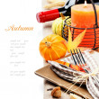 Thanksgiving table setting with pumpkins and candle - Стоковая фотография