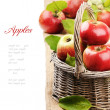 Fresh organic apples in wicker basket — Stock Photo
