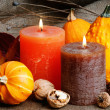 Autumn setting with candles and pumpkins - Stock Photo