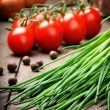 Fresh cherry tomatoes and chives — Stock Photo