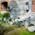 Vintage backyard with gardening tools — Stock Photo