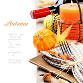 Thanksgiving table setting with pumpkins and candle — Stok fotoğraf
