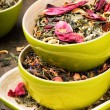 Mix of dry green and flower tea - Stock Photo