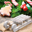 Christmas decoration with mini sleigh - Stock Photo