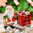 Santa Clause with Christmas gift — Stok fotoğraf