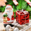 Santa Clause with Christmas gift - Stock Photo