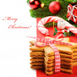 Christmas gingerbread cookies in festive setting - Stock Photo