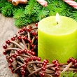 Christmas advent wreath with burning candle and festive decorati - Stock Photo