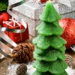 Christmas tree candle on festive background - Stock Photo