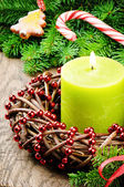 Christmas advent wreath with burning candle and festive decorati — Stock Photo
