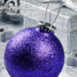 Purple Christmas bauble on silver background - Stock Photo