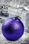 Purple Christmas bauble on silver background — Stock Photo