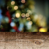 Old wooden table with festive background — Foto de Stock