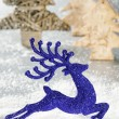 Christmas deer running in  snowing forest - Stock Photo