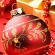 Christmas ball on festive background — Stock Photo
