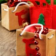 Christmas presents next to festive fir tree - Stock Photo