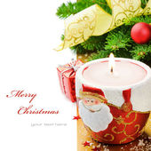 Red Christmas candle on festive background — Stock Photo