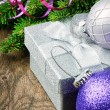 Christmas gift box and festive decorations - Stock Photo