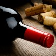 Bottle of red wine and corks — Stock Photo