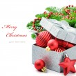 Christmas gift box with festive decorations - Stock Photo