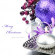 Festive candle and purple Christmas ball — Stock Photo