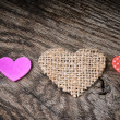 Stock Photo: Colorful hearts on wooden background