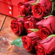 Bouquet of red roses and gift box — Stock Photo #19076089