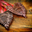 Two wicker hearts on wooden table — Stock Photo #19183121