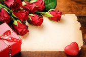 Valentine's frame with red roses and vintage paper — Stock Photo
