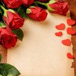 Stock Photo: Frame with red roses and vintage paper