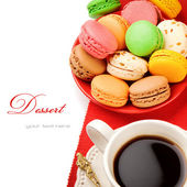 Colorful macaroons and coffee — Stock Photo