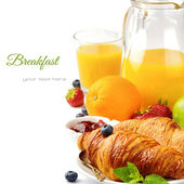 Breakfast with orange juice and fresh croissants — Stock Photo