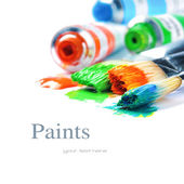 Colorful paints and artist brushes — Stock Photo